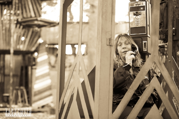 Rickie Lee Jones uses the pay phone on site to sing through it